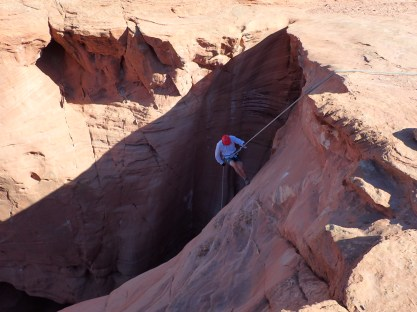 Jonno rappelling into Larry's canyon