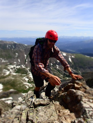 Jonno climbs along the ridgeline